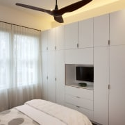 A bank of modern cabinets lines one entire bed frame, bedroom, ceiling, floor, home, interior design, light fixture, lighting, room, wall, gray