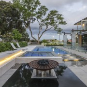 This new poolscape features a swimming pool with architecture, condominium, estate, home, house, property, real estate, resort, swimming pool, gray