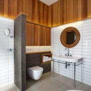 Natural light floods this remodelled bathroom in an architecture, bathroom, floor, interior design, plumbing fixture, product design, room, tile, gray, brown