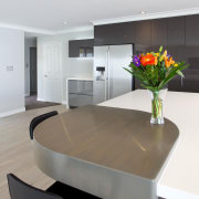 A key feature of the design of this countertop, furniture, interior design, kitchen, product design, table, white