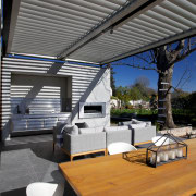 This outdoor entertaining area incorporates stainless steel cabinets architecture, daylighting, house, interior design, roof, gray, black