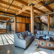 This converted heritage building, formerly a laundry, has ceiling, estate, interior design, living room, real estate, wood, brown