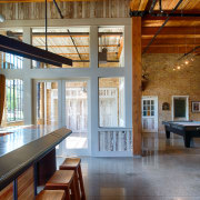 In this converted heritage building, entertainment facilities, including beam, ceiling, daylighting, interior design, real estate, window, wood, gray, brown