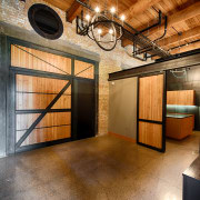 A large barn door provides the private entry ceiling, interior design, lobby, real estate, wood, brown