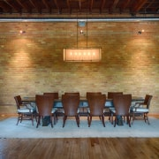 The formal dining area in this converted heritage architecture, brick, ceiling, chair, dining room, floor, flooring, furniture, hardwood, house, interior design, real estate, room, table, wall, wood, wood flooring, brown