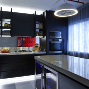 The concrete ceiling and services in this apartment countertop, interior design, kitchen, black, gray