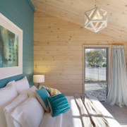 The new Lockwood show home in Christchurch features bedroom, ceiling, daylighting, estate, home, house, interior design, real estate, room, window, wood, gray