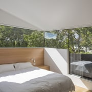 In this new house, windows from the Fairview architecture, bed frame, bedroom, ceiling, daylighting, estate, home, house, interior design, property, real estate, room, suite, window, wood, gray
