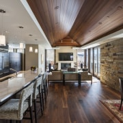 A vaulted wood ceiling on the living floor ceiling, countertop, dining room, flooring, hardwood, house, interior design, kitchen, living room, real estate, wood flooring, gray, black