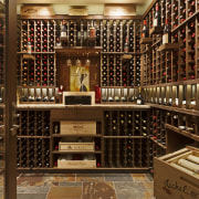 This wine cellar is in a Colorado mountain inventory, liquor store, wine cellar, winery, brown, red