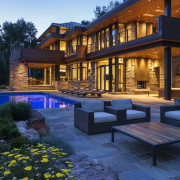 Large patios provide ample space for outdoor entertaining architecture, backyard, estate, evening, facade, home, house, landscape, landscape lighting, landscaping, lighting, mansion, outdoor structure, patio, property, real estate, reflection, residential area, siding, swimming pool, blue