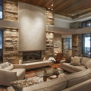 Dry-stacked limestone walls extend from the outside to ceiling, estate, fireplace, home, interior design, living room, real estate, room, window, brown