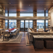 Dry-stacked limestone walls extend from the outside to ceiling, dining room, hardwood, interior design, living room, real estate, wood, brown, red