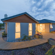 This new show home in Kerikeri was built cottage, estate, facade, home, house, property, real estate, roof, shed, siding, sky, teal