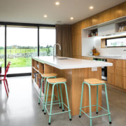 A planked veneer adds warmth to the modern, countertop, interior design, kitchen, real estate, room, table, white, gray