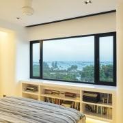 The master suite in this remodelled apartment occupies estate, interior design, property, real estate, room, window, orange