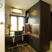 The master suite in this remodelled apartment occupies ceiling, furniture, interior design, room, black, brown