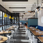 Upholstered banquette seating reinforces the cruise ship analogy interior design, restaurant, gray, black