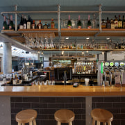 The bar occupies a central position in The liquor store, restaurant, black