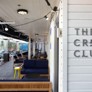 The Crew Club bar and eatery occupies the vehicle, white, gray
