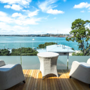 Wood deck with glass balustrade on Devonport home estate, furniture, outdoor furniture, property, real estate, resort, sea, sky, sunlounger, table, vacation, villa, white, teal