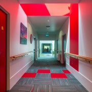 Bright Resene paints signpost different bedroom suites in architecture, ceiling, floor, flooring, hall, interior design, lobby, red