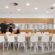 The communal hub in the Brookfield Multiplex office dining room, floor, flooring, furniture, interior design, property, real estate, room, table, gray