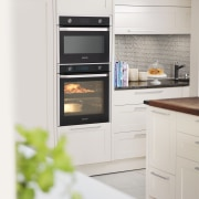 The Samsung 75-litre Dual Cook oven includes a countertop, home appliance, kitchen, kitchen appliance, kitchen stove, major appliance, microwave oven, oven, refrigerator, white