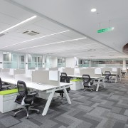 The monochromatic grey and white staff workstations in architecture, ceiling, daylighting, interior design, office, gray