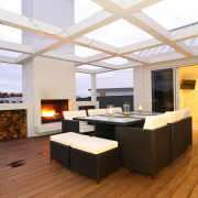 A large outdoor deck with barbecue fire and ceiling, floor, interior design, living room, real estate, white