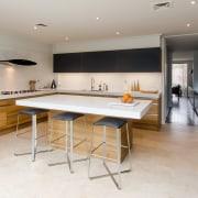 Pepper Design is the Australian importer of Poggenpohl countertop, floor, flooring, interior design, kitchen, real estate, room, table, gray