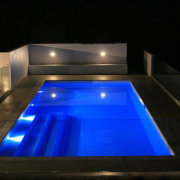 This fibreglass pool is by Mayfair Pools agent architecture, daylighting, light, lighting, reflection, swimming pool, black