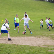 Research shows that the benefits of childrens participation ball, ball game, blue, competition, competition event, football, football player, fun, games, grass, lawn, leisure, plant, play, player, running, soccer, sport venue, sports, sports training, summer, team, team sport, tournament, green