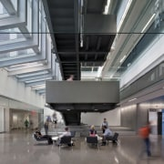 The lobby level at the bottom of the airport terminal, architecture, building, daylighting, lobby, metropolitan area, gray
