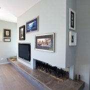 Designer colours set off the interior of this fireplace, floor, hearth, home, interior design, living room, room, wall, gray