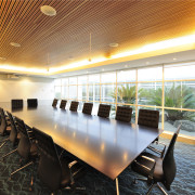 A feature ceiling sets off the conference room architecture, ceiling, conference hall, function hall, interior design, real estate, table, orange