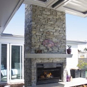 The experienced team at Fires by Design takes fireplace, hearth, gray, white