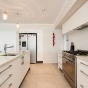 This serene kitchen splashback features crafted tilework  countertop, cuisine classique, floor, interior design, kitchen, property, real estate, room, gray