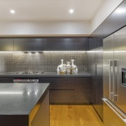 Under-cabinetry LED-light strips provide task lighting that complements architecture, cabinetry, ceiling, countertop, interior design, kitchen, real estate, room, under cabinet lighting, gray