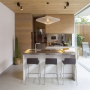 This kitchens pantry is concealed behind a shiny architecture, dining room, furniture, house, interior design, kitchen, real estate, table, gray