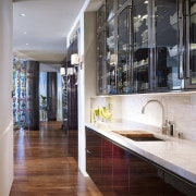 This bar with wine storage features the same countertop, floor, flooring, interior design, kitchen, gray