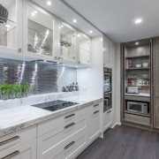 On this kitchen project by designer Kira Gray, cabinetry, countertop, cuisine classique, home appliance, interior design, kitchen, gray