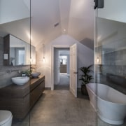 While the shower cubicle is slotted into an architecture, bathroom, ceiling, daylighting, floor, flooring, home, interior design, real estate, room, tile, wood flooring, gray