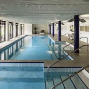 A generous sized swimming pool is provided for leisure, leisure centre, property, real estate, swimming pool, gray, teal