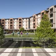 The design of the Poynton retirement village comprises apartment, building, campus, city, condominium, estate, facade, home, metropolitan area, mixed use, neighbourhood, plaza, property, real estate, residential area, urban design