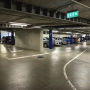 A generous site-wide underground carpark is provided for metropolitan area, motor vehicle, parking, parking lot, public space, black, gray