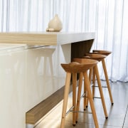 The folded timber element on this kitchen island chair, floor, furniture, product, product design, table, wood, white