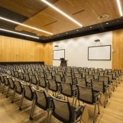 The acoustically balanced lecture hall at the new auditorium, ceiling, conference hall, function hall, interior design, orange, brown