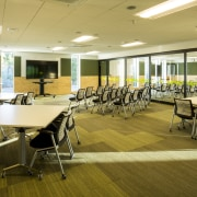 Glass-walled rooms at the Rotorua Health and Science conference hall, interior design, office, table, brown, orange
