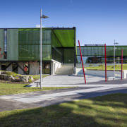 The new Health and Science Centre at the architecture, grass, public space, recreation, sky, structure, teal